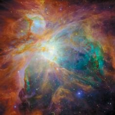 This magnificent image from NASA's Spitzer and Hubble space telescopes shows the Orion Nebula in an explosion of infrared, ultraviolet, and visible-light colors.