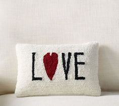 The sweet sentiment on this pillow is stitched by hand using a hook-and-loop technique. It makes a cozy gift for a loved one on Valentine's or any day. LOVE Lumbar Pillow   Pottery Barn
