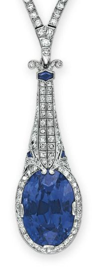 RosamariaGFrangini | HighJewellery Antique | An Art Deco Sapphire and Diamond Necklace, by TIFFANY & CO. Suspending a detachable pendant, centering upon an oval-cut sapphire, weighing approx. 29.59 carats, within a circular-cut diamond surround, from a tapered circular-cut diamond and calibré-cut sapphire plaque, to the circular-cut diamond neckchain, mounted in platinum, circa 1920, 14½ ins. Pendant signed Tiffany & Co. (hva)