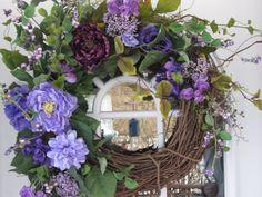 inserzione di Etsy su https://www.etsy.com/it/listing/184677946/purple-foral-spring-wreath-decorated