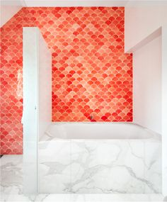 Keep up with tile trends. Fish scale tiles are a great way to update your kitchen or bathroom. Replace your subway tile with fish scale tile to stay on trend. For more design ideas and inspiration, go to Domino. Deco Design, Tile Design, Bathroom Inspiration, Interior Design Inspiration, Design Ideas, Mermaid Tile, Orange Bathrooms, Marble Bathrooms, Fish Scale Tile