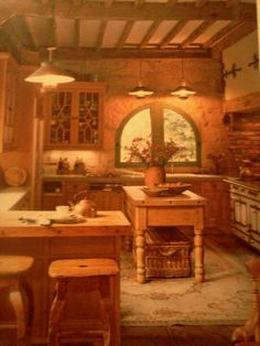Such an inviting kitchen exuding the warmth of hearth and home. From the Spring/Summer 2007 issue of Country French Decorating magazine