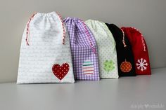 Drawstring Treat Bag Tutorial by SimplyNotable.com. These are perfect for small gift giving. They come together quickly and are a great way to use up scraps! #iloverileyblake