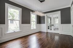 Drooling over the Paint Color, Moulding, and Floor Dining Room Wainscoting, Dining Room Paint, Dining Room Design, Dining Rooms, Grey Walls Living Room, Living Room With Fireplace, Living Room Chairs, Wayne Scotting Walls, Grey Walls White Trim