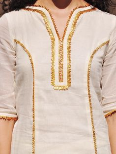 Ivory-Mustard Gota Embellished Cotton Kurta-Lehenga & Dupatta Set of ivory and gold Sharara set has an old world charm with its delicate and lightweight finish in soft mulmul fabric. Its well tailored and finely Salwar Neck Designs, Neck Designs For Suits, Kurta Neck Design, Sleeves Designs For Dresses, Dress Neck Designs, Kurta Designs Women, Blouse Designs, Kurti Embroidery Design, Embroidery Suits