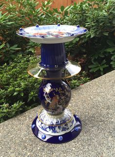 SOLD-These creative garden art collections can be used indoor or outdoors as plant stands, bird feeder or birdbath. This is repurposed glass I have collected from second hand stores, garage sales, and department stores (Marshall's, TJMaxx, etc).  These are hand made and designed by Karen Talbot