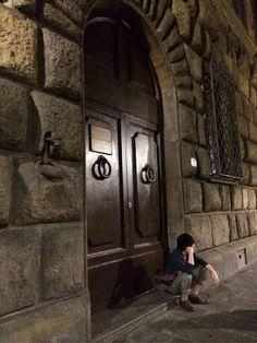Soraru sitting in front of a door?
