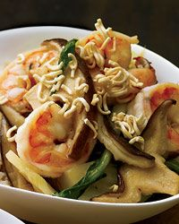 Shrimp-and-Bok Choy Stir-Fry with Crispy Noodles |   Takashi Yagihashi cooks scallops, squid and shrimp in stock, soy sauce, sugar, vinegar, chili oil, sesame oil and mirin, then tops the dish with crispy deep-fried noodles.  For a healthier version of the recipe, stir-fry shrimp in a small amount of oil and top with a light sprinkling of crunchy instant ramen noodles.