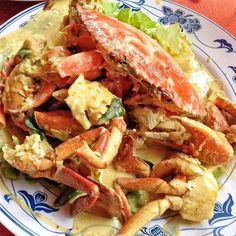 """Keng Eng Kee has my pick for Singapore's best Salted Egg Crab because of its creamy and addictive salted egg sauce. Their secret ingredient is infusing the sauce with """"wok hei"""" before tossing in the crabs. This results in a salty and smoky flavour that will make you want to mop up every last drop of sauce with your Deep Fried Mantou. 