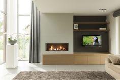 Gashaard in totaalwand met eiken kast  legplank Gas fireplace in total wall with oak cabinet and shelf