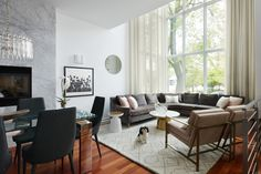 For the Boss family, Homepolish's Guinevere Johnson took a 4-story Chicago space and transformed it into a contemporary family abode. With the white colorway and the giant shining windows, the whole space simply sparkles. Izzy (the family dog) seems to approve at least.