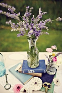 Lavender centerpiece with books (from my own wedding!) | At Home in Love
