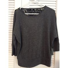 Grey shirt Black lace accent on back. Keyhole. Tops