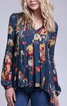 From Blu Pepper, this floral print peasant top features: all over floral print woven fabric split v neckline embroidered detail long sleeve peasant silhouette with loose fit pullover construction rayo