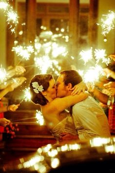 Instead of throwing rice or blowing bubbles, why not illuminate the bride and groom with sparklers?