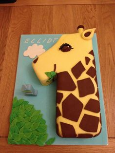 I like that the number one becomes the giraffe!  This is cute!  I would do it with frosting rather than fondant. @koesterjl
