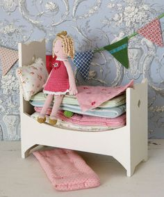 As a gift for a little girl's baby shower, DIY this princess and the pea doll toy, except instead of mattresses, fill it with pretty facecloths or folded onesies. Adorable and functional.