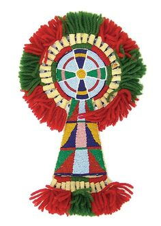 """Crow Horse Rosette Circa Late 1900s, Classic design fully beaded """"keyhole"""" forehead rosette done on rawhide and fully beaded with Crow motif. Trimmed with red and green wool yarns."""