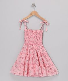 <p+style='margin-bottom:0px;'>The+flowers+pop+right+off+the+pretty+pink+background+of+this+twirl-worthy+dress.+It's+comfy+and+quaintly+stylish+with+a+fully+smocked+bodice+and+bitty+shoulder+ties+that+are+adjustable+for+that+perfect+fit.<p+style='margin-bottom:0px;'><li+style='margin-bottom:0px;'>100%+cotton<li+style='margin-bottom:0px;'>Machine+wash;+hang+dry<li+style='margin-bottom:0px;'>Imported<br+/>