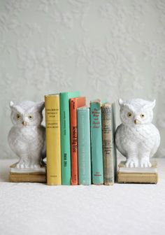 "Owls Of Wisdom Bookends 49.99 at shopruche.com. Keep your reading material in line with two winged guardian bookends. Hand painted, these two snowy owls perched atop stacks of books have foam bottoms for stability while combining your collection of novels and magazines.  Approx. 8""H x 4.5""W  Base: 3.75""L x 2.74""W x 1.75""H"