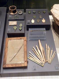 Museo de Badalona (Barcelona, España)   by Rafael del Pino.   Writing. 9.- Stylus or bone awl on a wax tablet réplica. 10.- Stylus. Bone. 11.- Stylus Bronze. 12.- Seal boxes.