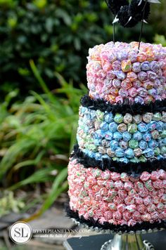 What a fun alternative for a cake! Using dum dums! Just use foam, suckers, and some ribbon or streamer! Tiered Dum Dums  Cake