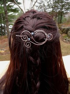 *Pretty swirl/spiral shawl pin brooch with stick. *Handmade filigree wirework design. *Made of solid copper metal. *Featuring beautiful soft aqua blue translucent and iridescent beads reflecting purple tones when they catch the light. *This jewelry piece is very versatile... you may