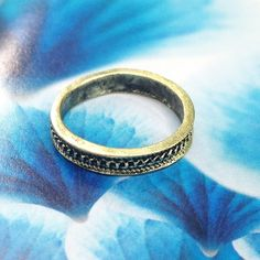 Gold tone Band Ring Lovely band ring!! Gold tone ring with antique look. Chain tunnel carved design. Size 5. 3mm tall band, 1 - 1.5mm thick. Listing includes one ring. Perfect on its own or in addition to your stacks. Cute & chic!  HOST PICK Best in Jewelry May 26 2016 Candymuse Jewelry Rings