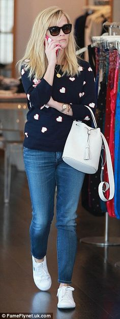 Reese Witherspoon catches the eye in ice blue blouse #dailymail