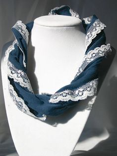 Another version of the tshirt + lace scarf. Would be easy to make.