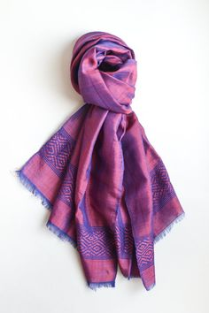 Handmade by artisanal weavers in Ethiopia using organic cotton, silk and traditional techniques Azola presents the Indigo Purple Scarf. Let this stylish