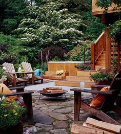 The best backyards are those designed for multiple uses. Here, for example, the family added an inviting stone and concrete patio below their deck. One end of the patio has a seating area surrounding a fire pit, while at the other end there's additional seating next to an above ground spa.