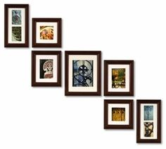 I like the arrangement - http://www.wanelo.com/home-and-office/Pinnacle+Frames+and+Accents+7-Piece+Photo+Frame+Set%2C+Walnut+Solid+Wood-839397.html