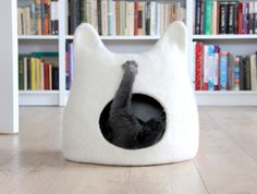 """Cats love to lounge in boxes, but having a bunch of empty cartons in your home adds little in terms of decor. Agne Audejiene of Agnes Feltcreates colorful felted """"cat caves"""" that provide your feline with cozy places to sleep and stalk while incorporating a stylish, modern pet accessory into your home. Available in a …"""