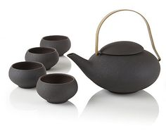 A Teavana Exclusive! ::: Pebble Teapot Set ::: Each stoneware tea set includes one 34oz (1L) teapot with micromesh stainless steel infuser basket and four tea cups. Shop: http://www.teavana.com/tea-products/teapots-teapot-sets/ceramic-teapots/p/pebble-teapot-set