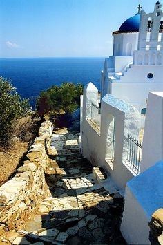 Church of Panagia Poulati and paved alley. Sifnos island, Cyclades, Greece