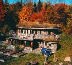 cordwood house AND built into side of hill (better temp control because of the earth's insulation), AND solar AND gardens... ahhhh. oh, and a living roof.