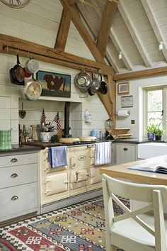 mix of warm tone wood beams and white washed on vaulted ceiling