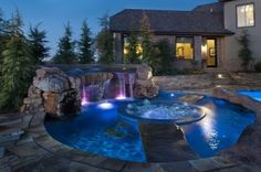 Backyard pool with hot tub in the middle
