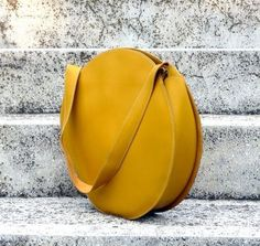 Love this round yellow leather purse