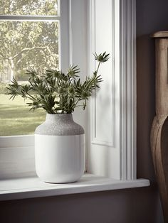 £18.50 Crafted from ceramic with a two tone white gloss and grey matt glaze, our petite vase sits beautifully within a Scandinavian inspired interior. Each piece has an elegant cylindrical shape, with rounded edges and a tapered rim.