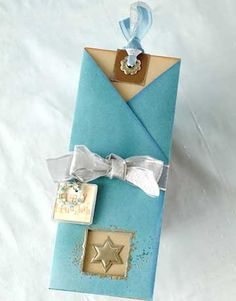 Put a spin on the traditional Hanukkah card by making a slider card with a coordinating sleeve. /