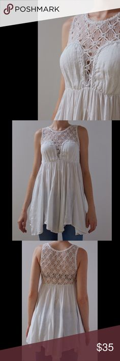 Free People white tunic White Free People tunic/long tank with crochet detail. All offers are considered! Free People Tops Tunics