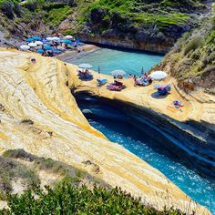 Corfu ,Greece ...  The famous Channel of Love (known as Canal d' Amour) is an idyllic area with unique rock formations that form a series of wonderful coves and canals. The rocks run in different shades of yellow and lots of greenery at the top.