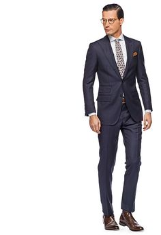 Peak Lapel Navy Herringbone Suit from Suit Supply (I would prefer it with out the herringbone pattern; instead plain or with a very subtle pinstripe).