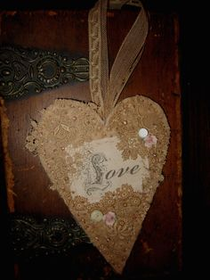 Vintage Lace Cotton Batting Embellished Heart   Love Scroll. $16.99, via Etsy.