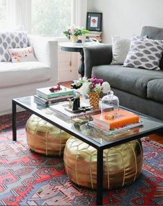 Use a coffee table that's open underneath to store small stools or poufs for extra seating