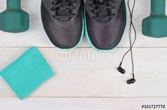 Woman workout concept. Fitness background. Sport  shoes, dumbbells, earphones on white background