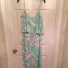 Lilly Pulitzer L Harrington Maxi in Skye Blue NWT This amazing maxi was released in summer 2015 and quickly sold out. It is very flattering with the billowy top and the colors are beautiful against the white background. This dress is new with tags and has never been worn! It's the perfect addition to your closet heading into spring and summer! I hate to have to sell it, but it just doesn't fit me anymore! Also accepting offers. Lilly Pulitzer Dresses Maxi