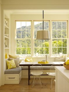 picture perfect breakfast nook with big picture windows, open shelving, bench seating with storage below | Ken Linsteadt Arhictects
